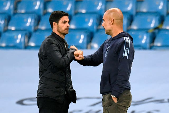 Guardiola (right) drew a distinction between Arsenal on and off the pitch in his praise of the Gunners