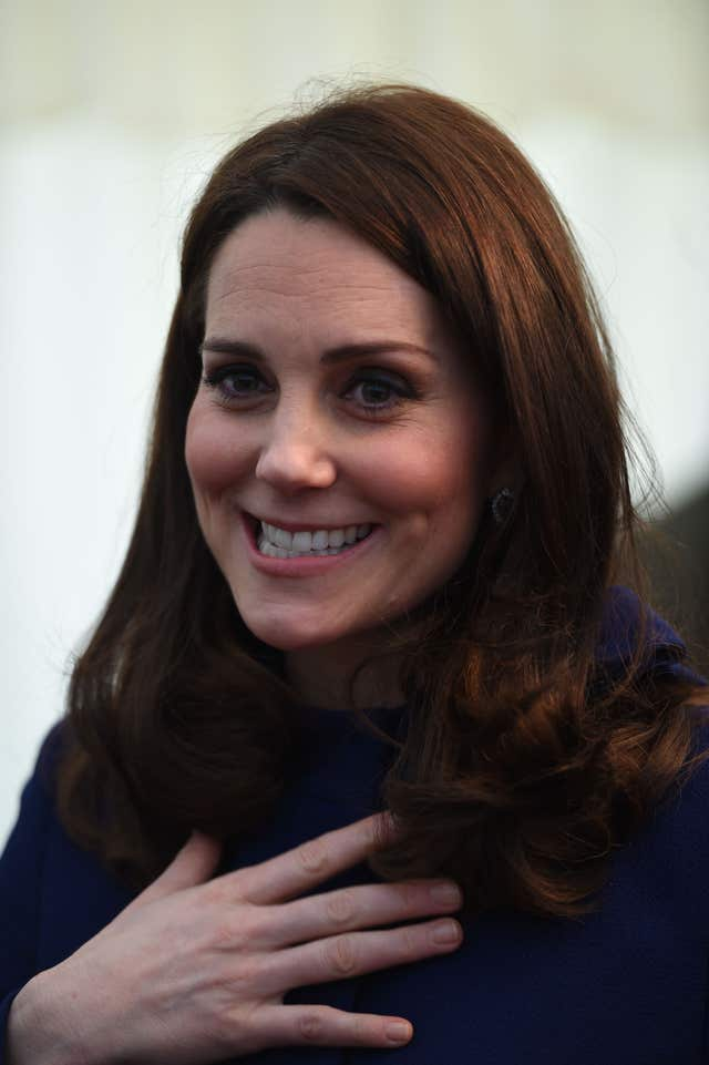 The Duchess of Cambridge carried on smiling after getting her heel caught briefly (Eddie Mulholland/Daily Telegraph/PA)