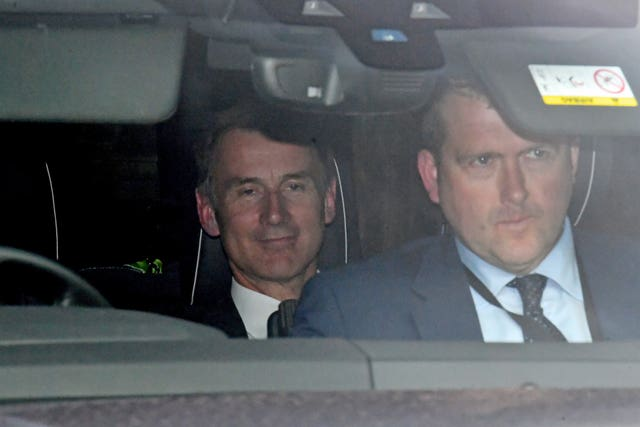 Jeremy Hunt leaves Parliament following the fifth vote