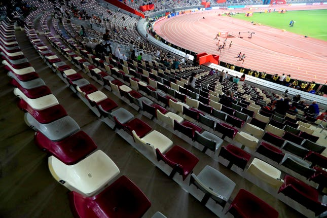 The Women's 200 metres heats take place in front of banks of empty seats