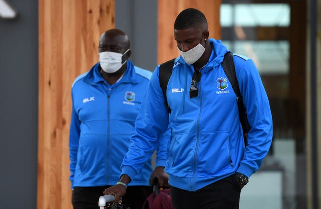 Roddy Estwick arriving at Manchester Airport with West Indies captain Jason Holder