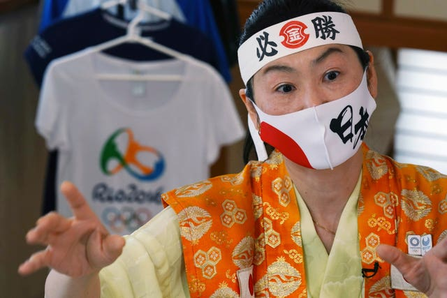 Olympic fan Kyoko Ishikawa speaks during an interview at home in Tokyo
