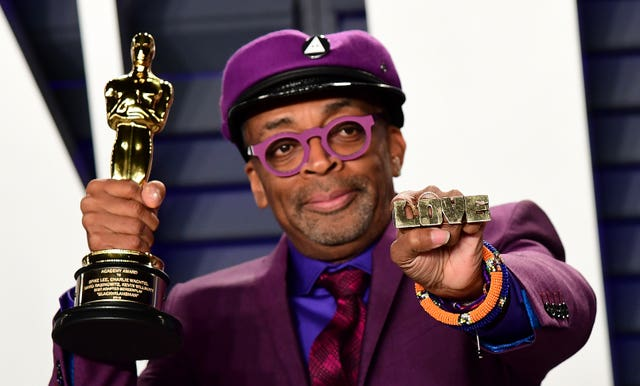 Spike Lee holds up his Oscar for Best Adapted Screenplay