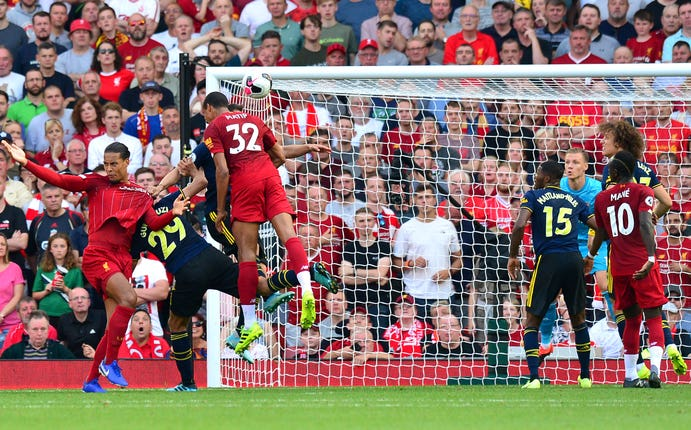 Joel Matip heads in the opener as Liverpool beat Arsenal 3-1 to maintain their winning start to the season