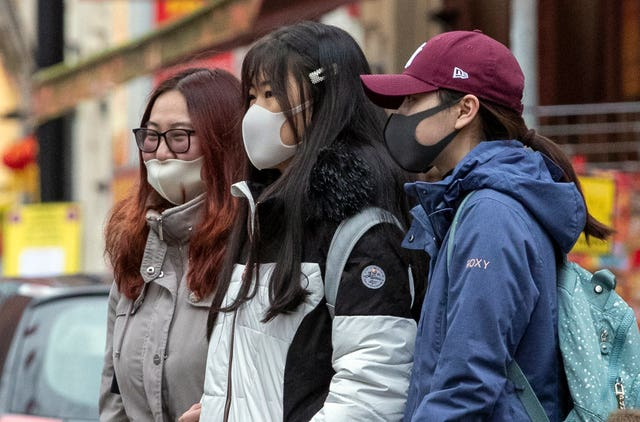 Members of the Chinese community in Manchester wearing face masks (Peter Byrne/PA)