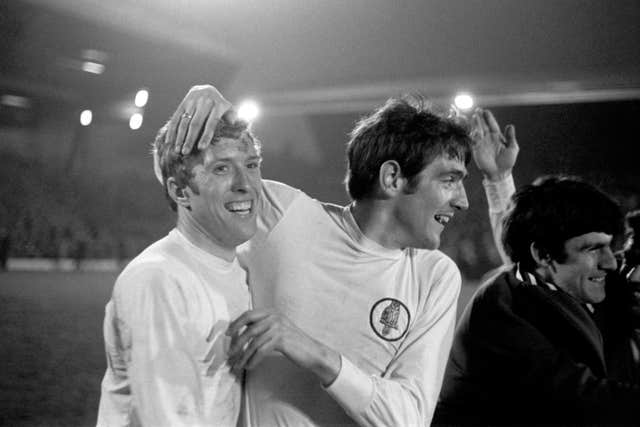 Hunter, right, celebrates with Leeds team-mate Mick Jones after securing the 1969 First Division title