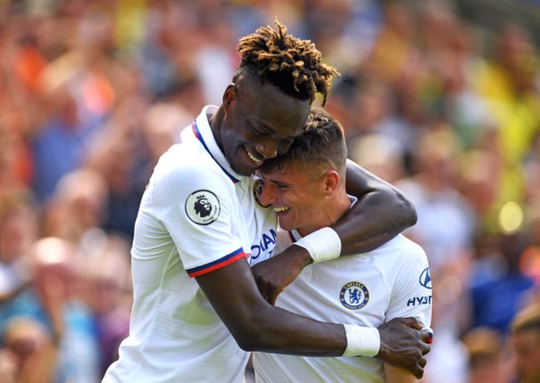 Tammy Abraham hugs Mason Mount as the pair's goals secure Chelsea a 3-2 win at Norwich