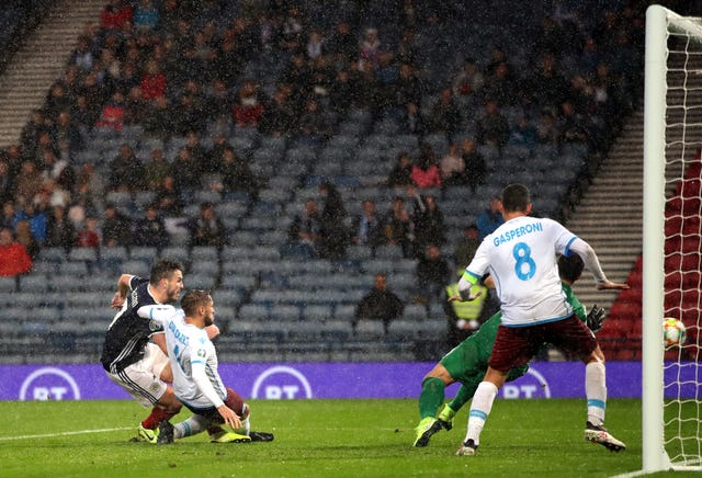 John McGinn completes his hat-trick as Scotland saw off San Marino in extremely wet conditions at Hampden Park