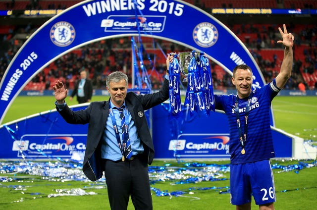 Terry, pictured alongside Jose Mourinho, claimed three League Cups with the Blues