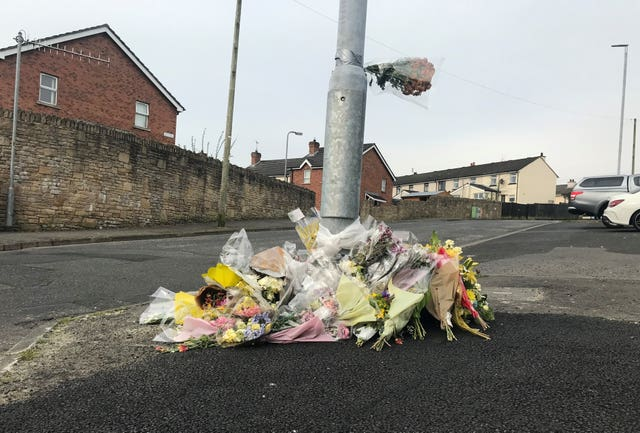 Flowers at the spot where Lyra McKee was killed in Creggan