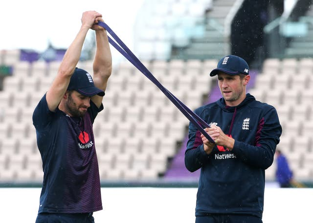 Mark Wood, left, and Chris Woakes warm up together ahead of a net session