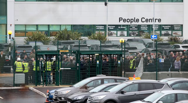 Jaguar Land Rover staff gather at work