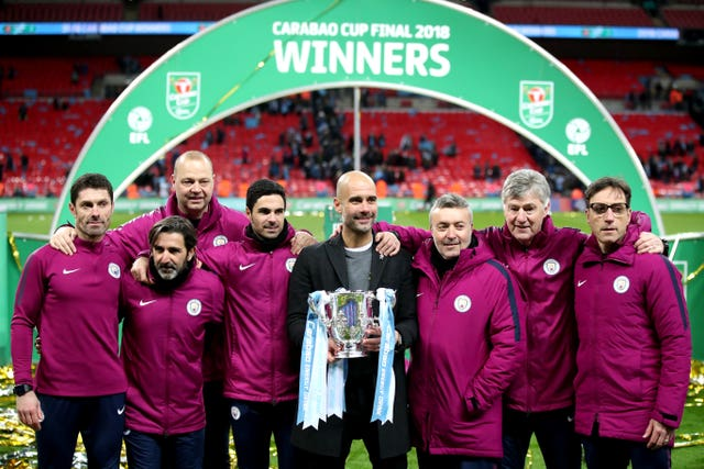 Guardiola collected his first silverware in England as his City side blew Arsenal away in their Carabao Cup final meeting.