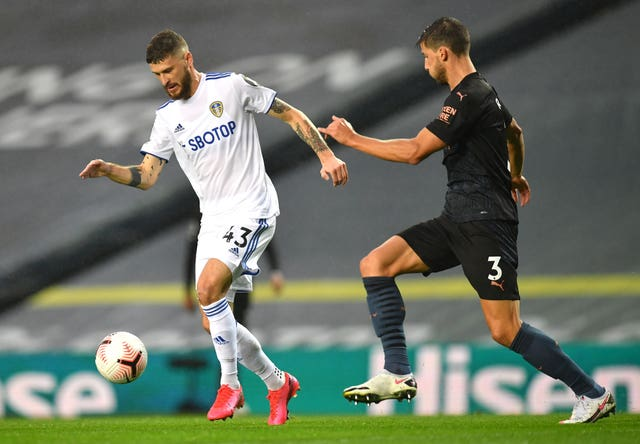 Mateusz Klich, left, relishes his lung-busting role in Leeds' midfield