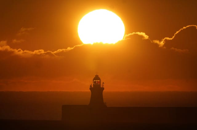 The sun rises over South Shields lighthouse