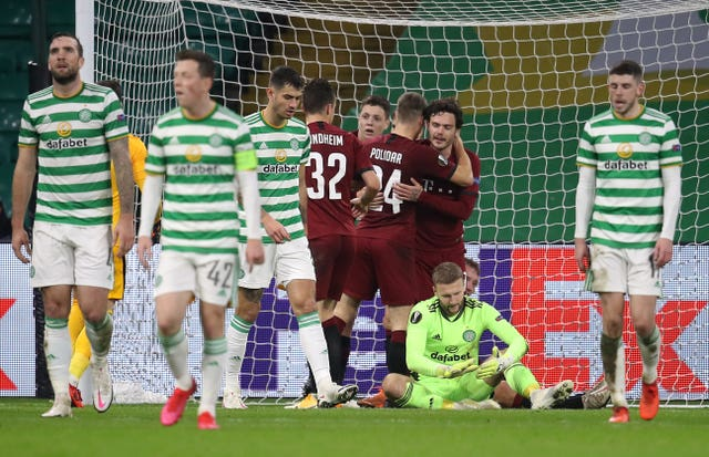 Celtic players trudge back to position after Sparta Prague's Lukas Julis completes his hat-trick