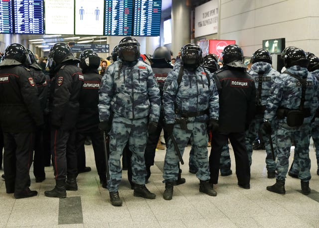 Police officers stand guard at Vnukovo airport