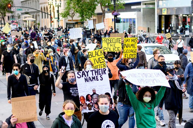 Demonstrators march in Oakland to protest the death of George Floyd