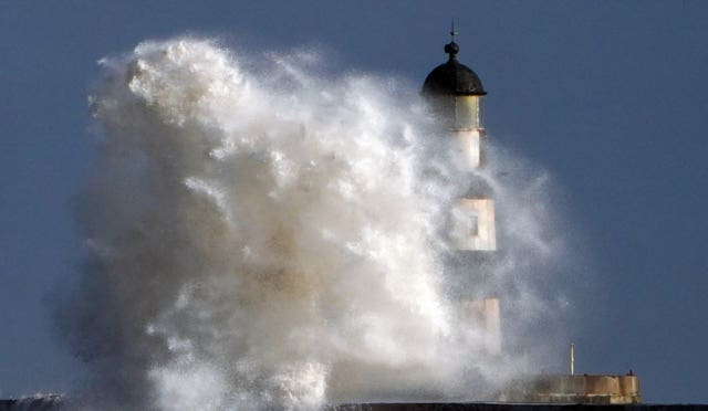 Waves hit the lighthouse at Seaham in Durham
