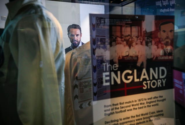 Gareth Southgate looking at exhibits at the National Football Museum in Manchester