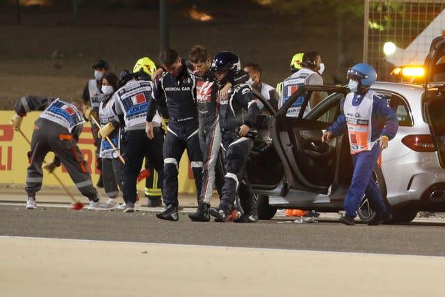 Romain Grosjean is helped by medical staff (