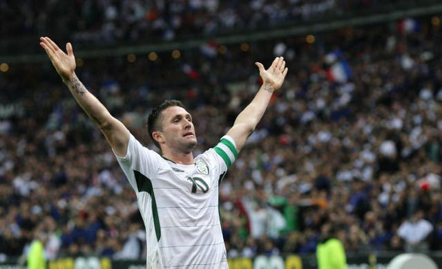 Republic of Ireland striker Robbie Keane celebrates after scoring at the Stade de France