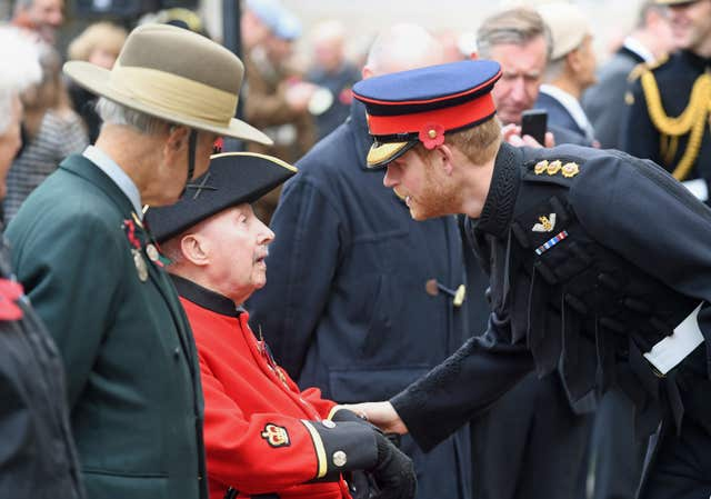 Prince Harry meeting veterans at Westminster Abbey's Field of Remembrance last year