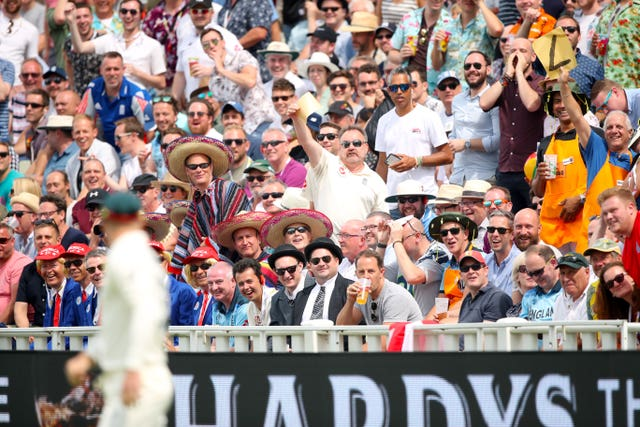 Spectators in the Hollies Stand offer David Warner some sandpaper during the opening Ashes Test