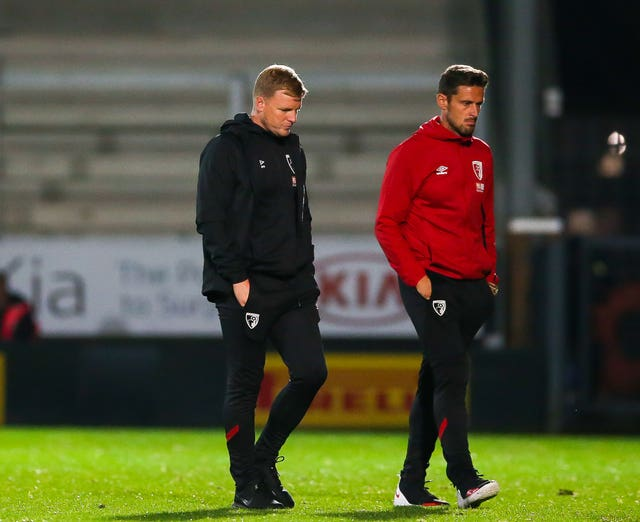 Eddie Howe, left, and his assistant Jason Tindall have accepted significant pay cuts