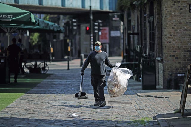 A street cleaner at Camden Market