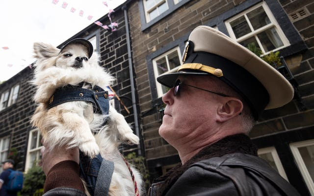 A man and his dog during the Haworth 40s weekend