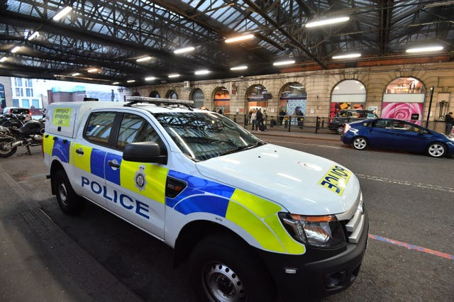 Police at Waterloo after a small parcel bomb was found (John Stillwell/PA Wire)