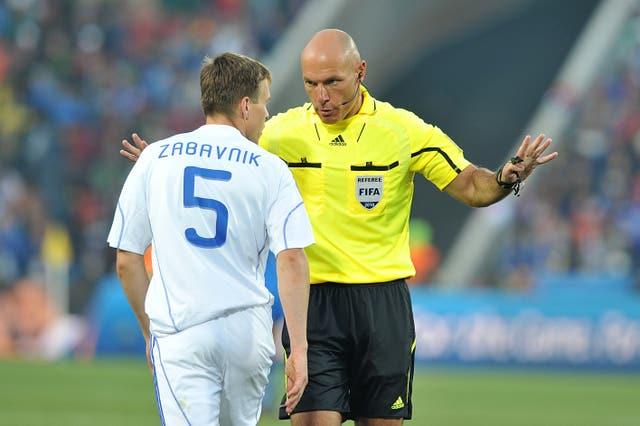Match referee Howard Webb disciplines Slovakia's Radoslav Zabavnik (left)