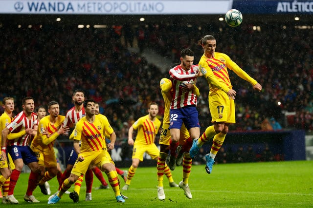 Antoine Griezmann, right, was playing against his former club