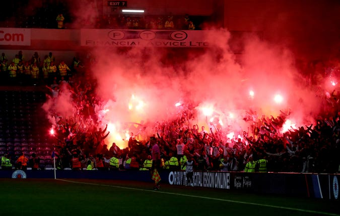 Legia fans set off flares in the stands