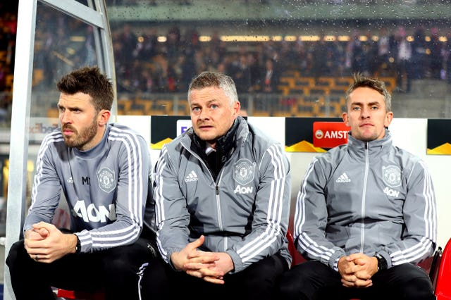 Ole Gunnar Solskjaer alongside coaches Michael Carrick and Kieran McKenna in Manchester United's last match before the lockdown in Austria