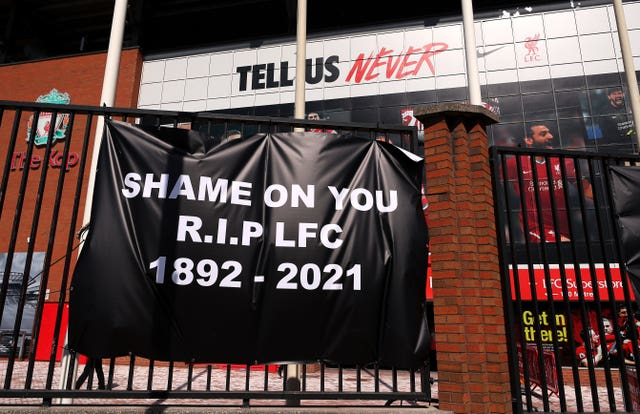 Banners are placed outside of Anfield, home of Liverpool FC by fans to protest against its decision to be included amongst the clubs attempting to form a new European Super League.