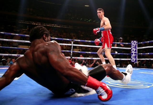 Callum Smith, right, knocks Hassan N'Dam to the canvas