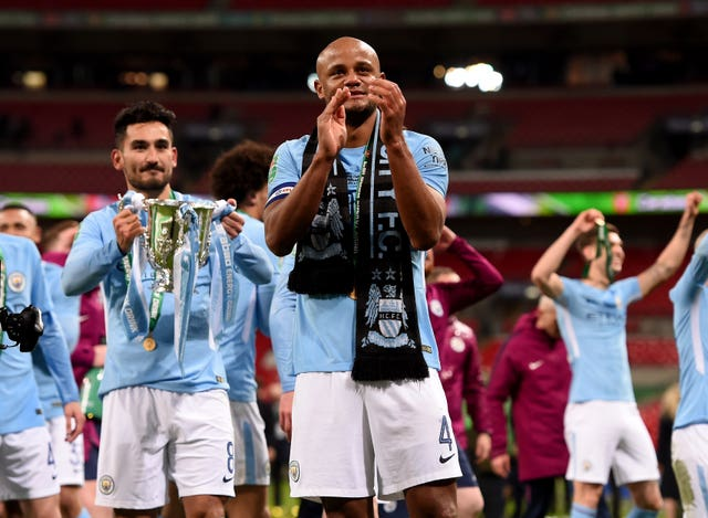 Ilkay Gundogan holds the League Cup after City beat Arsenal 3-0 in 2018