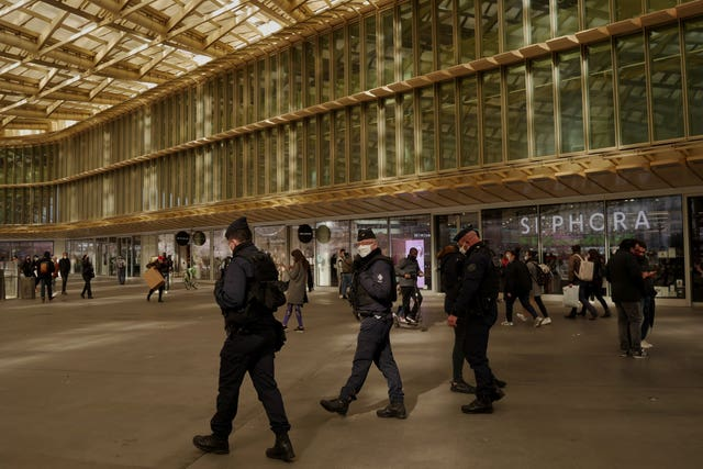 Police officers patrol in the Chatelet area in Paris