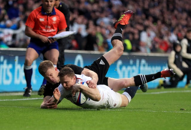 Chris Ashton, right, scores against New Zealand at Twickenham