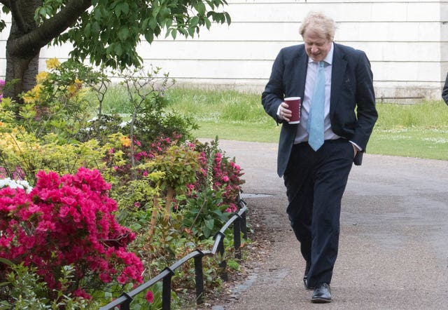 Boris Johnson takes a morning walk in St James' Park