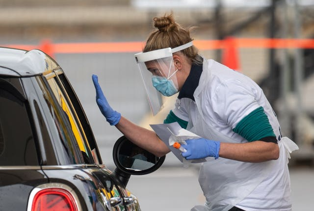 Staff collect samples at a drive through test centre in Leicester (Joe Giddens/PA)