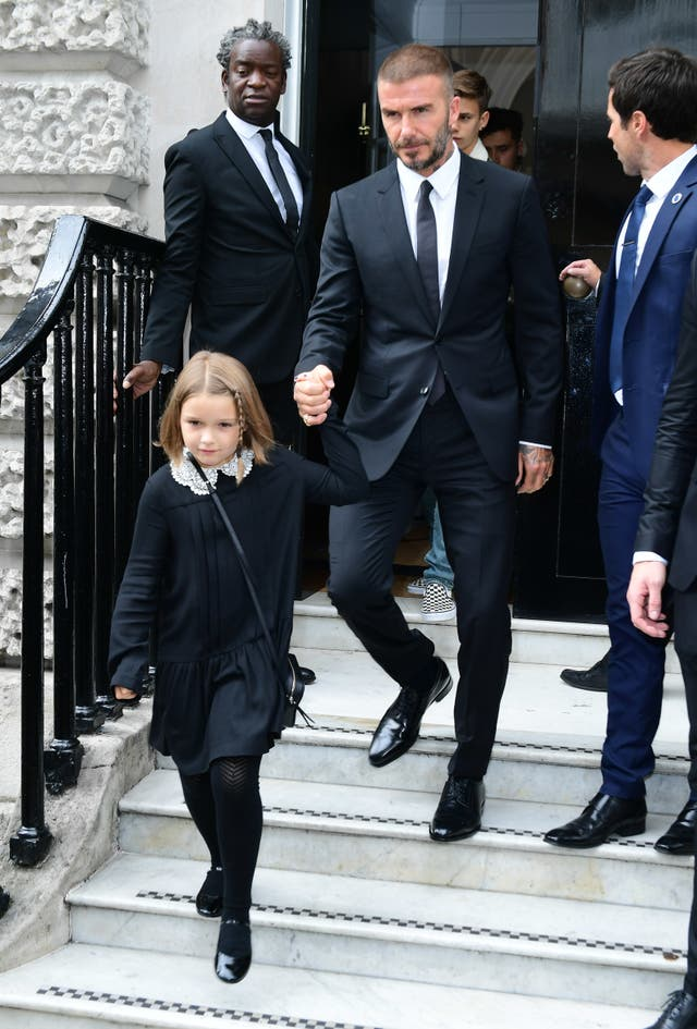 David Beckham and his daughter Harper leave the show