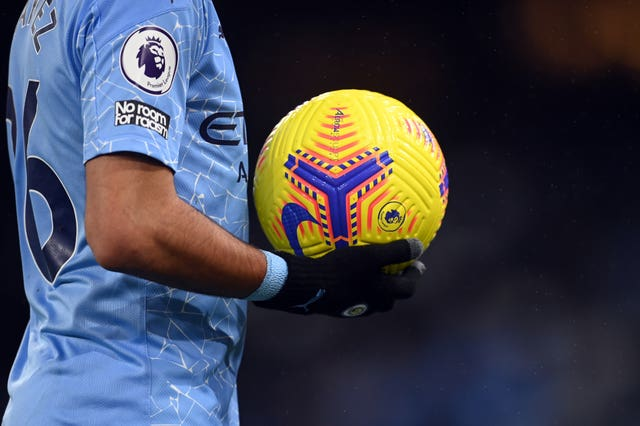 Riyad Mahrez leaves with the match ball
