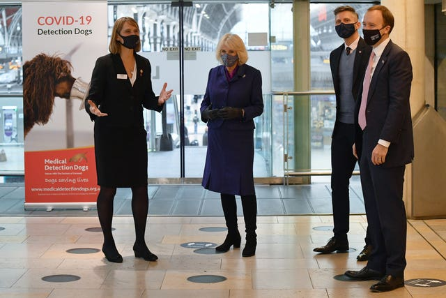 The Duchess of Cornwall (centre) and Health Secretary Matt Hancock (right) watch a demonstration by the charity Medical Detection Dogs. Justin Tallis/PA Wire