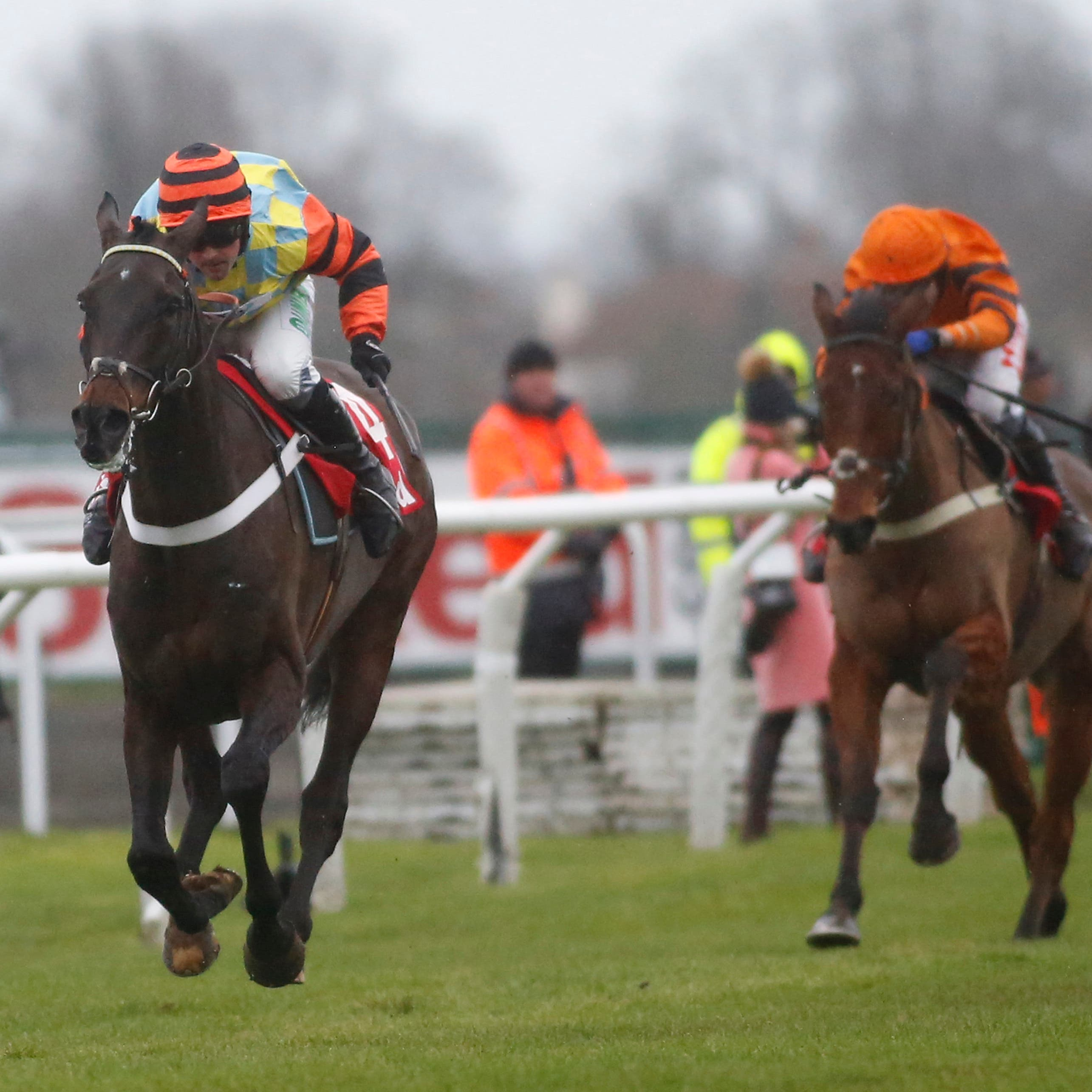 Might Bite (left) strides to victory in last year's King George VI Chase