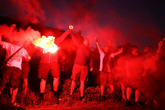 Liverpool fans let off flares outside Anfield as they celebrated being crowned champions