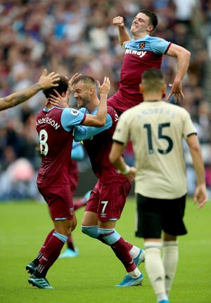 Andriy Yarmolenko celebrates the opening goal