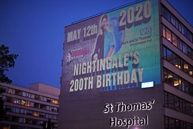 An image of Florence Nightingale is projected on to Guy's and St Thomas' hospital in London